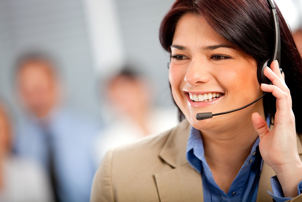 Business woman at the office wearing a headset