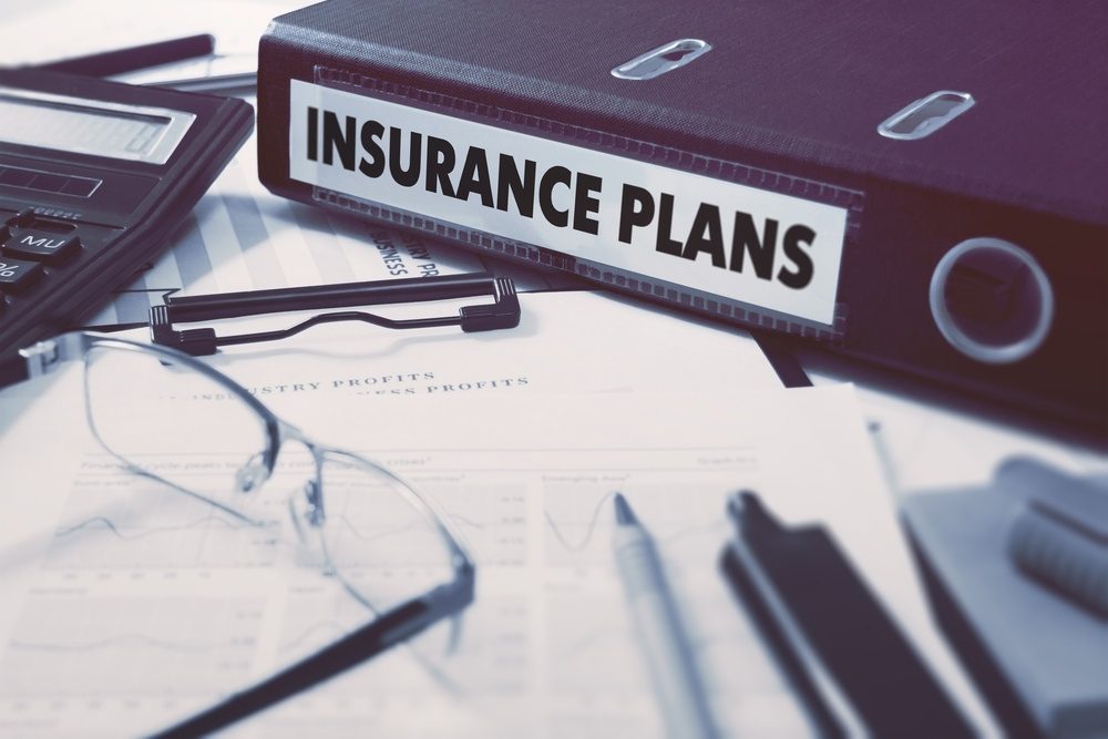 Insurance Plans - Ring Binder on Office Desktop with Office Supplies. Business Concept on Blurred Background. Toned Illustration.-1